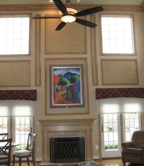 Focal wall of family room with high ceiling